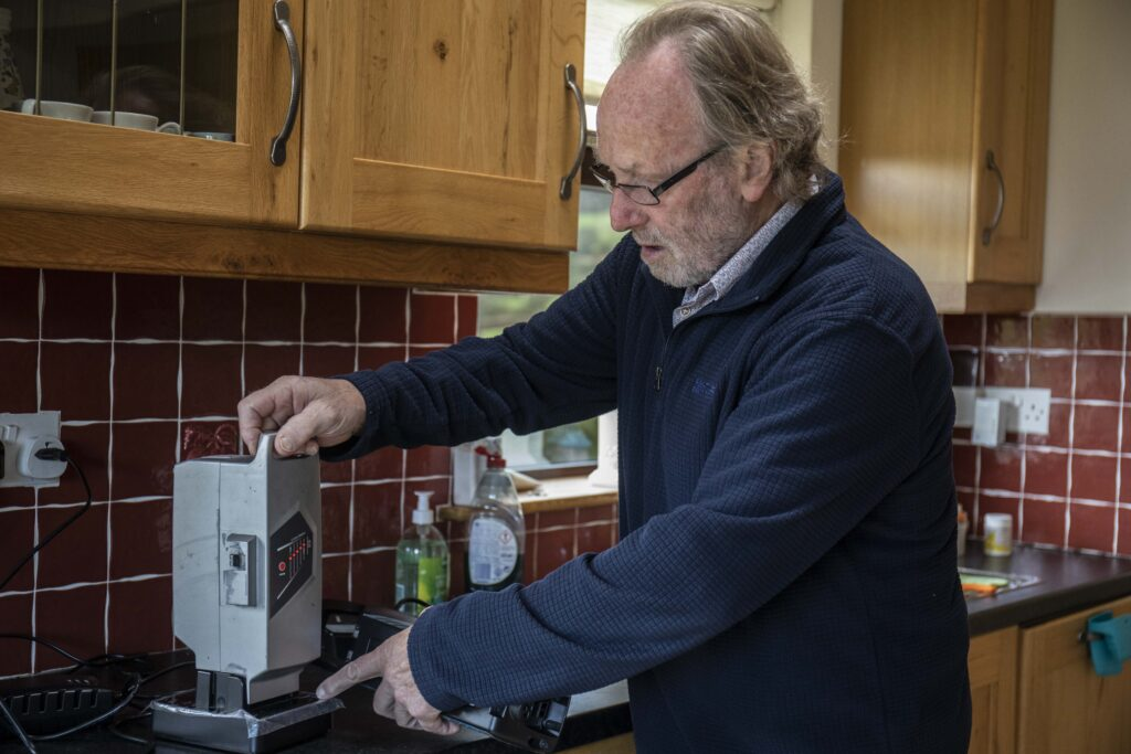 Paddy Lane of Mallow, Co. Cork charging an electric bicycle battery in his home.