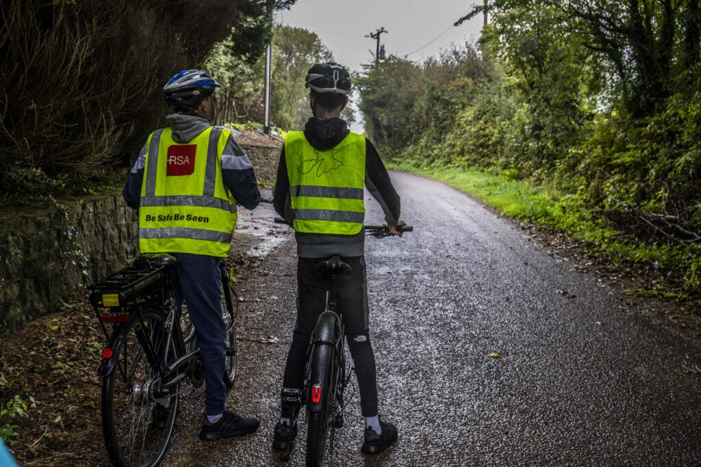 Conor O'Callaghan and his younger brother, Cormac, of Kinsale, County Cork on a country road with their electric bicycles.