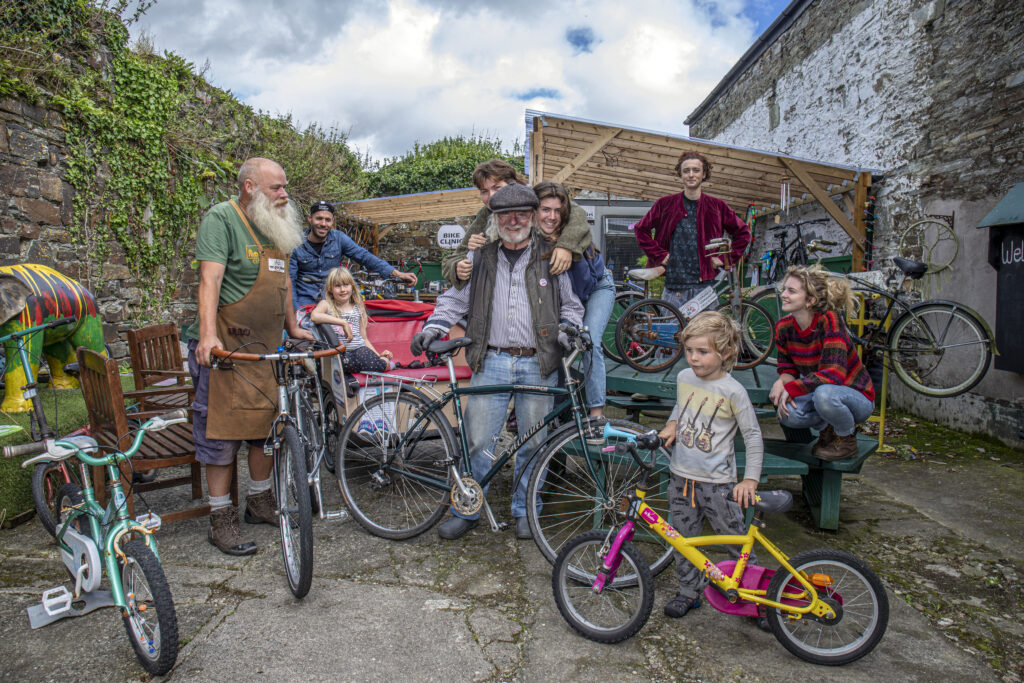 Jack Kelleher of Clonakilty, West Cork surrounded by people and with his electric bicycle.
