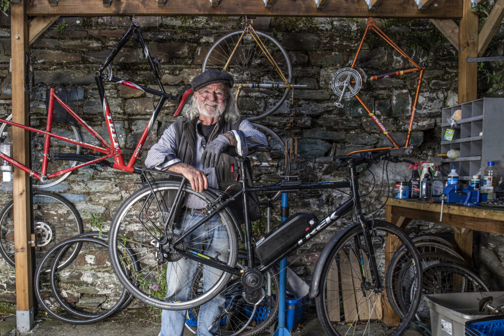 Jack Kelleher of Clonakilty, West Cork in a workshop with his electric bicycle.