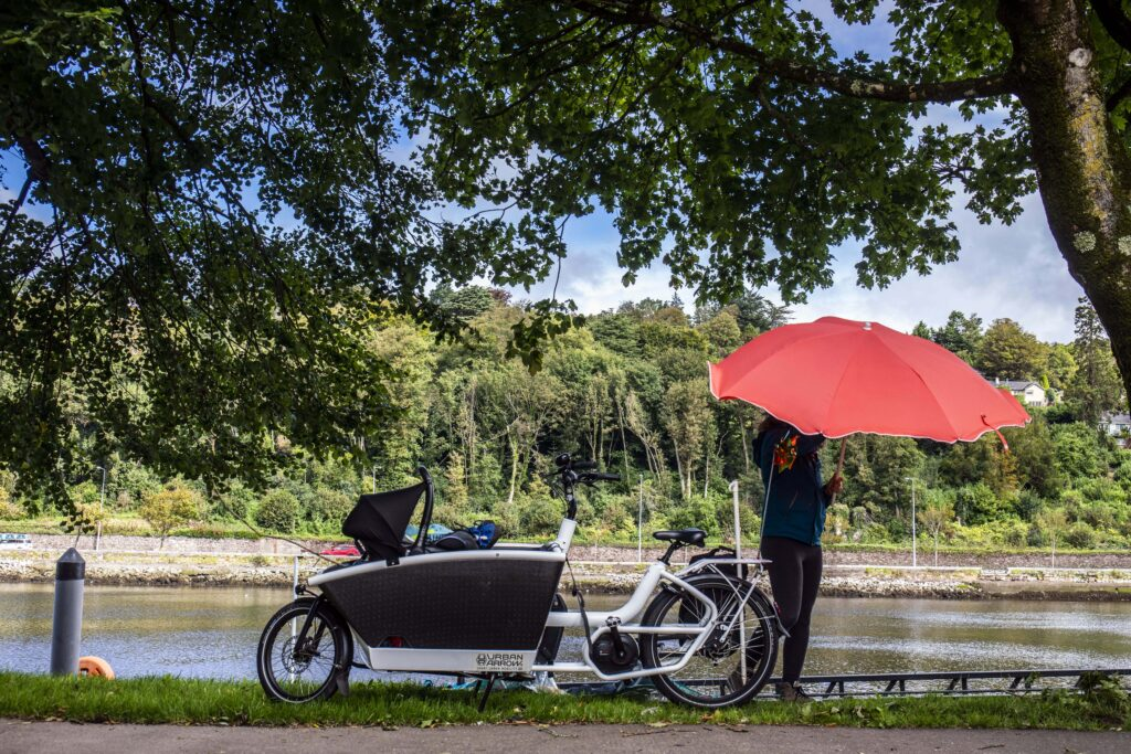 Orla Burke of Cork with her electric cargo bicycle with a parasol at the Marina in Cork.