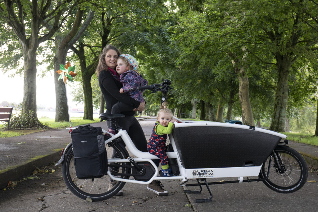 Orla Burke of Cork with her children and electric cargo bicycle.