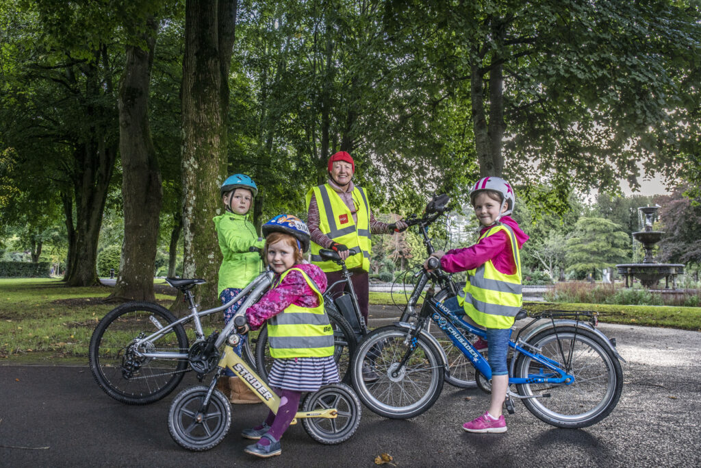 Siún Kearney of Cork with her grandchildren and her electric bicycle.