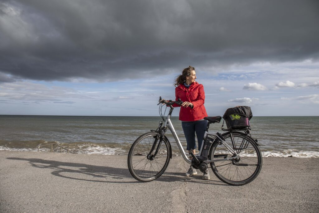 Teresa Watkins of Youghal, Co. Cork standing with her electric bicycle at the sea front in Youghal.