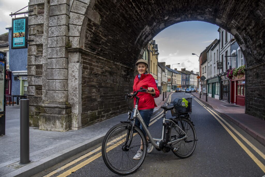 Teresa Watkins of Youghal, Co. Cork with her electric bicycle in Youghal town centre.