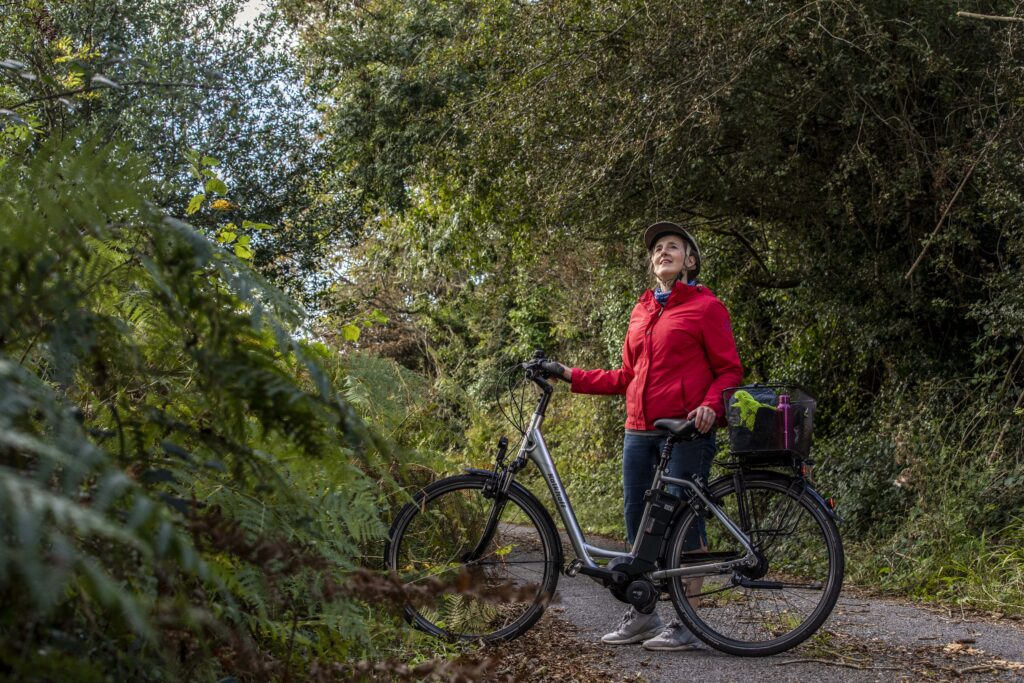 Teresa Watkins of Youghal, Co. Cork wihth her electric bicycle on a country road.