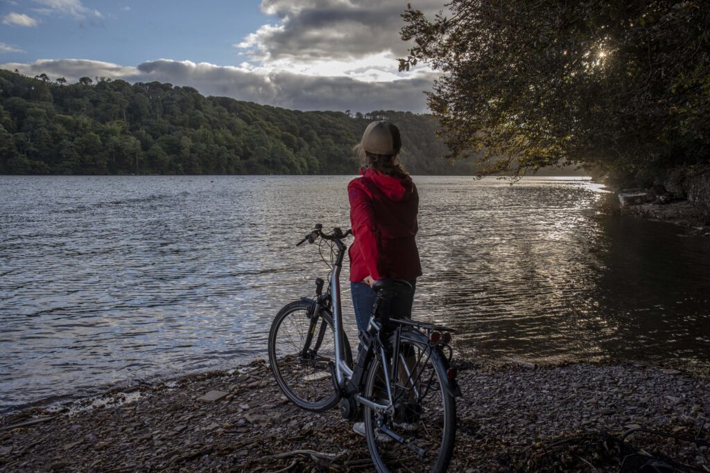 Teresa Watkins of Youghal, Co. Cork with her electric bicycle near a waterfront.
